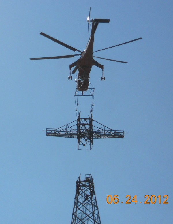 An aerial lift helicopter installs a tower section that will hold power lines on the Bucksport-Orrington line.