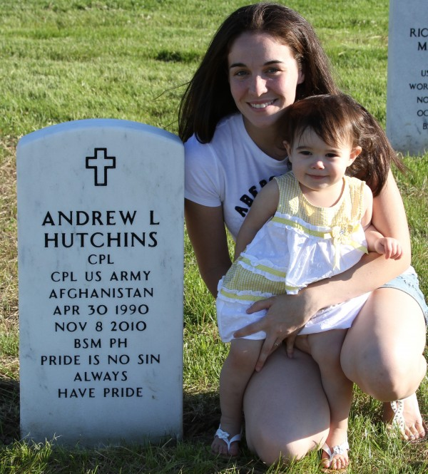 Heather Hutchins, 23, and her daughter Allyssa, age 18 months, of Solon are pictured next to the grave of Hutchins' husband, Andrew Hutchins, who was killed in Afghanistan in November 2010 at the age of 20.