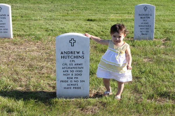 Allyssa Hutchins, age 18 months, of Solon, stands at the grave of her father, Andrew Hutchins, who was killed in Afghanistan in November 2010 at the age of 20.