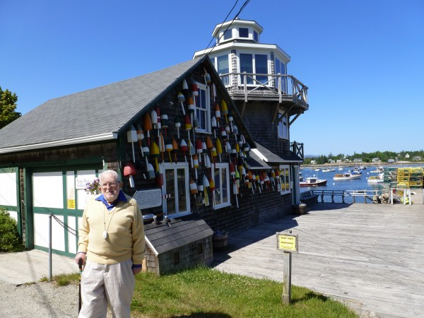 Irving Silverman stands in front of the nonoperational lighthouse his wife built for him before she died. In her memory, Silverman performed weddings as a notary public for years, marrying 34 couples. Now that Silverman is 92 years old and can no longer live alone in Maine full time, his notary license cannot be renewed.