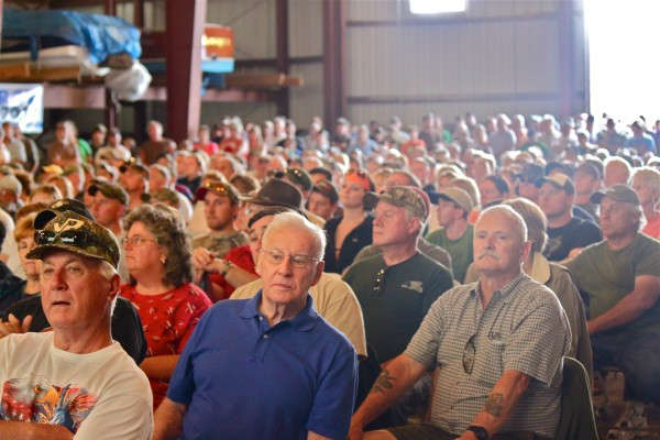 More than 600 people wait for their names to be called during the 2012 Moose Lottery Drawing in a boat storage building at Oquossoc Marine during the 2012 Rangeley Lakes Region Moose Lottery Festival on Saturday, June 23.