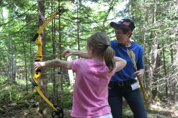 Kimberly Parker, 9, of Cape Cod, completes the 3-D archery course in Oquossoc during the 2012 Rangeley Lakes Region Moose Lottery Festival on Saturday, June 23.