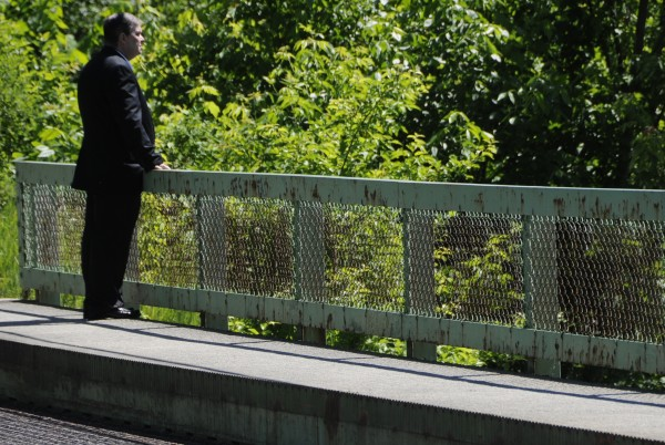 John Brainard II, father of Army pilot Capt. John &quotJay&quot Brainard III, stands quietly on a bridge near the family gathering for Capt. Brainard in Newport. The remains of Capt. Brainard, an Army pilot who was killed in a helicopter crash in Afghanistan on Memorial Day, were returned to Maine on Thursday morning, June 14, 2012.