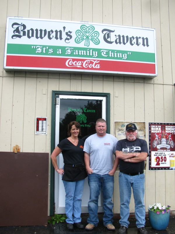 Motorcycle enthusiasts Kristi Brown of Lincolnville, Tony Runci of Belfast and Buzz Stultz of Belmont stand outside of Bowen's Tavern in Belfast on Wednesday afternoon, June 27, 2012. The three are among motorcycle riders upset about what they perceive to be an anti-rider sentiment among some in Belfast.