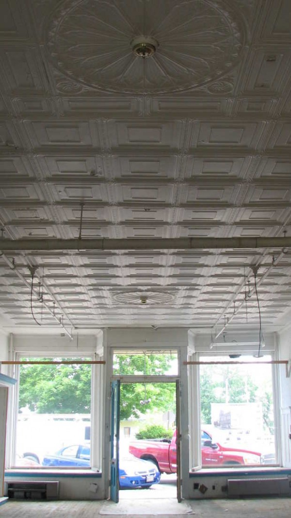 Volunteers have been working to clean out the six storefronts and cellars of the Norway Opera House in anticipation of going out to bid on a $1.1 million renovation project within the next few weeks. This storefront features a decorative tin ceiling with two chandelier medallions, built-in bookcases and wood floors.