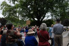 An estimated 100 people gathered at Peirce Park on Saturday for a rally in protest of state and federal budget cuts to programs that serve the poor. A march to Bangor organization effected by the cuts followed.