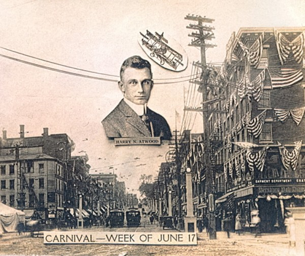 Harry Atwood, the daredevil aviator, gazed down on Main Street in this postcard commemorating the Bangor Street Fair and Carnival of 1912. Atwood''s appearance at the event was intended to mark the Queen City''s recovery from the great fire of the year before.