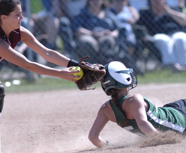 Old Town High School softball player Kayla Madden (5) slides under the tag of Nokomis High School player Lacey Kent-Webber, left,  for a steal at at second base in the the second inning of their Eastern Maine Championship game in Brewer, Thursday, June 14, 2012.