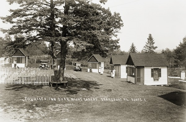 Located on Route 1 east of Searsport, the Tourists Inn and Cabins was among several cabin colonies in the area that offered a lodging alternative to the overnight camps and tourist homes of the 1920s and early 1930s. The sign &quotInspected and Licensed 1931&quot assured travelers of cleanliness.
