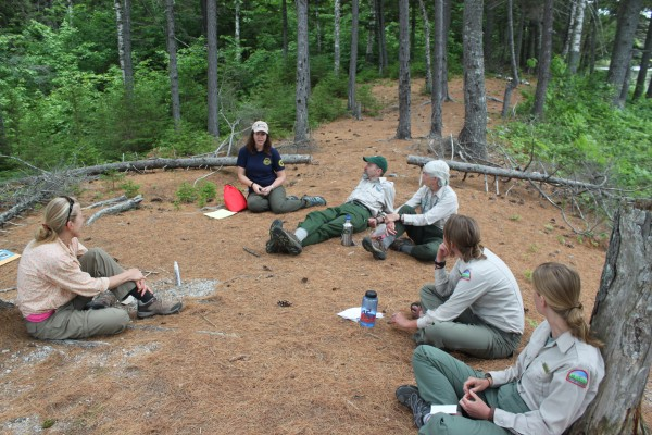 Leave No Trace Trainer Course students Carol Corkran (from left) and Sara Caldwell, sit in a circle with Leave No Trace master educators Gabe Williamson and Marcia Williamson, along with students Kelsey Johnson and Acadia Tripp on June 21 at Abol Narrows Campground in Baxter State Park while learning the principles of Leave No Trace.
