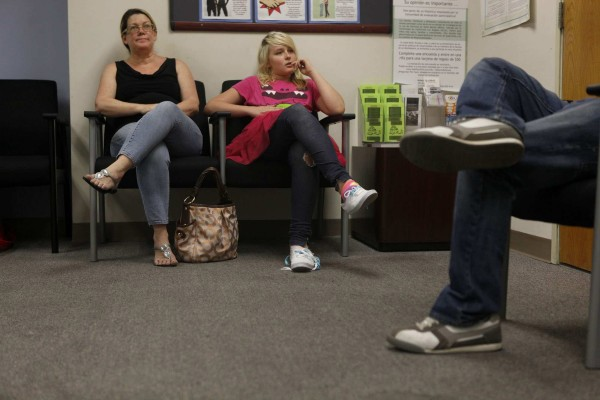 Michelle and Amber wait to pick up her medication.