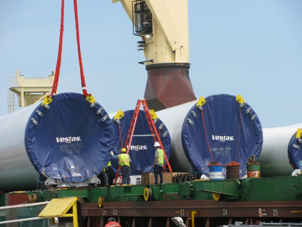 Workers unload tower components for wind turbines Tuesday, June 12, 2012 at Mack Point in Searsport. The parts are destined for First Wind's 19-turbine Bull Hill wind farm in Township 16 in Hancock County.