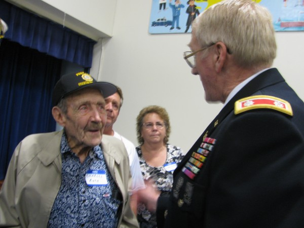 Charles Roth, 90, of Grand Junction, Colo., was thanked for his service Saturday at an event that honored the hometown war hero who saved Roth's life nearly 70 years ago. Jerry Dobbins helped Roth instead of getting on his parachute in 1943 when their B-17 plane was shot down by Nazis over occupied France. Dobbins died in the crash, but many of his surviving family members attended the event at the Stockton Springs Elementary School.