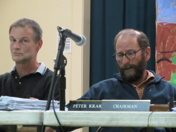 Warren Planning Board member David George (left) and Chairman Peter Krakoff deliberate over plans for a methadone clinic by CRC Health.