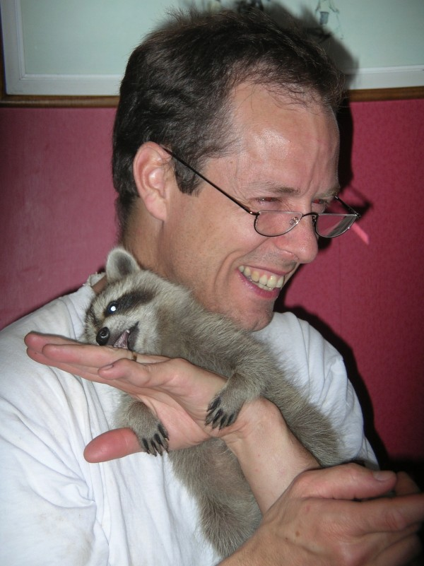 Jonathan with Michael the raccoon.