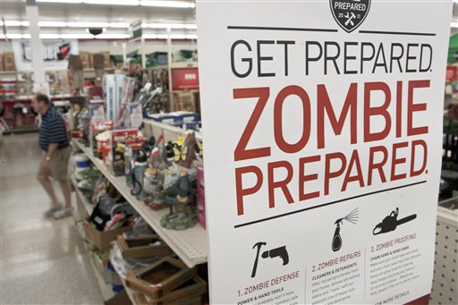 In this Monday, Oct. 10, 2011 file photo, a sign promoting zombie preparedness displays in a hardware store in Omaha, Neb. After several gory incidents that have been reported around the country recently, online zombie talk has grown.