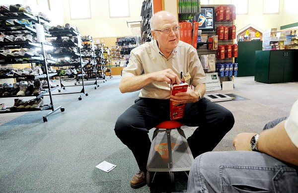 Harvey White talks with a customer about having insoles placed in his shoes at Lamey Wellehan in Auburn. He is one of five certified pedorthists in the Maine company.