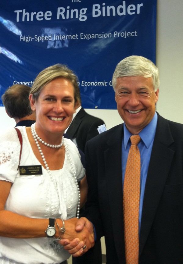 Cynthia Dill joins U.S. Rep. Michael Michaud, D-2nd District, at a press conference for the Three Ring Binder broadband infrastructure project in 2011.