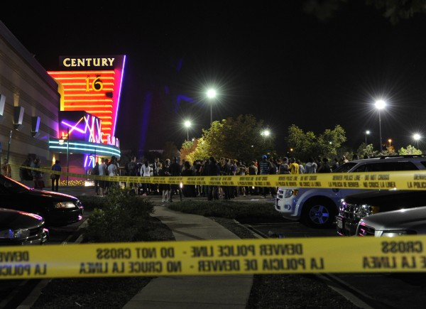 People gather outside the Century 16 movie theatre in Aurora, Colo., at the scene of a mass shooting early Friday morning.
