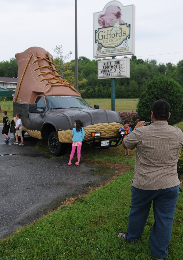 Oscar Martinez (right) photographs his children, Sofia and Oscar, in front of the L.L. Bean bootmobile as it visits Gifford's Ice Cream on Broadway in Bangor on Sunday, July 29, 2012.