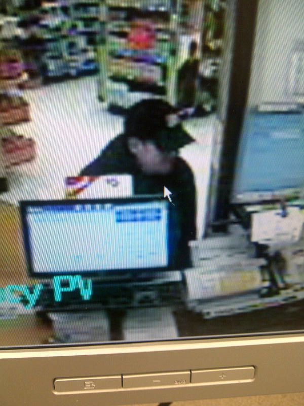 Surveillance footage of man Windham police say robbed a Walgreens pharmacy on Roosevelt Trail on Saturday.