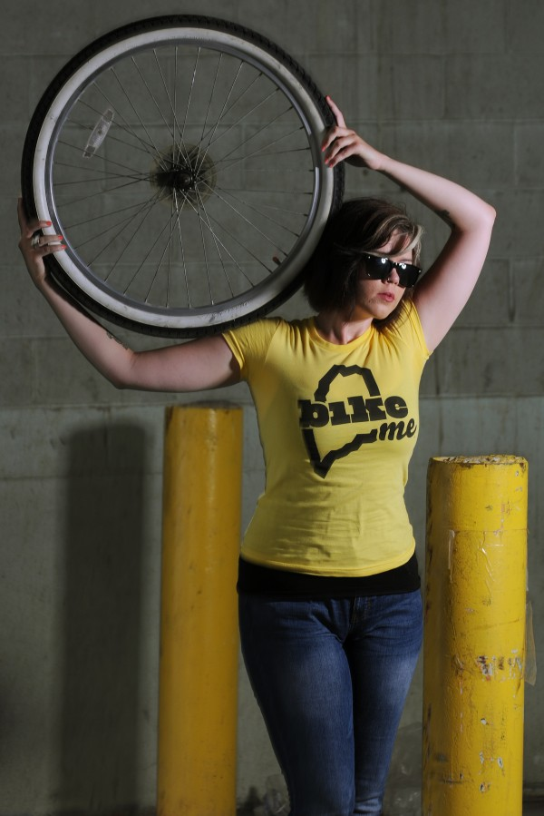 Self proclaimed hipster Sarah Farnham poses with a BikeME T-shirt in the BDN studio on Tuesday, July 24, 2012.