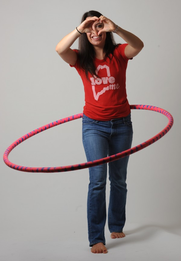 Christin Pelletier models a LoveME T-shirt while demonstrating her hula hoop skills at the BDN studio on Tuesday, July 24, 2012.
