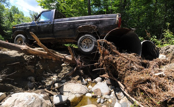 A driveway was washed away from under a pick-up truck that was parked over the culvert along the Stickney Hill Road in Brownville. The repair work following the recent flooding has created a huge financial burden for the town of Brownville.