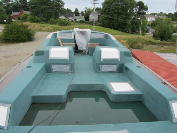 This 70-foot unfinished sailboat, as seen from the deck, will be up for auction on Wednesday, Aug. 1, 2012 at the Lyman Morse Boatbuilding in Thomaston.