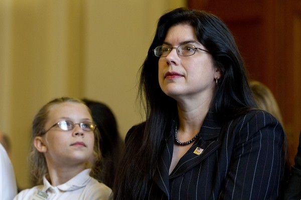 Samantha Moore, 10, looks up at her mother, Ruth Moore of Milbridge, as she listens before testifying at a  Veterans Affairs subcommittee on Disability Assistance and Memorial Affairs hearing about victims of military sexual trauma, on Capitol Hill in Washington on Wednesday.