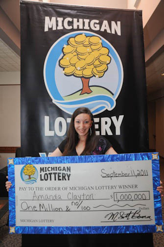In this file photo provided by the Michigan Lottery, Amanda Clayton holds her ceremonial $1 million lottery check. The 24-year-old Detroit-area woman who collected welfare despite winning the lottery prize was sentenced Tuesday, July 24, 2012 to nine months of probation. Attorney Todd Flood says Clayton has repaid about $5,500 in food aid and medical benefits. She pleaded no contest to fraud last month.