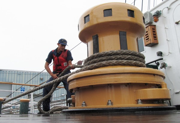 U.S. Coast Guard trainee Kent Altobelli tightens the line as the Barque Eagle arrives in Portland on Friday, July 27, 2012. The ship will open for public tours Friday, Saturday and Sunday.