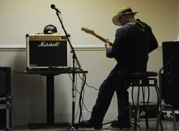 House band member Frank Dow warms up after a break while playing old country classics on Sunday, July 29, 2012, during Doug and Jeannie's Country Jam at the City Side Restaurant in Brewer.