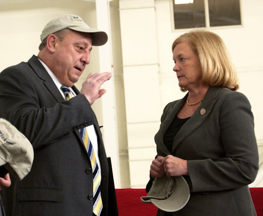 Gov. Paul LePage and U.S. Rep. Chellie Pingree talk at the Brunswick Naval Air Station in Feb. 2011.