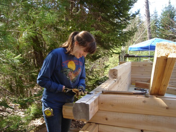 Paige Cote works to assemble a lean-to she built for Great Pond Mountain Conservation Trust in Orland to fulfill community service requirements to earn the Girl Scout Gold Award.