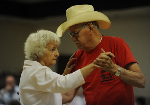 Frances Bogan of Bangor and Norm Pooler of Bingham dance to a slow country song on Sunday, July 29, 2012, during Doug and Jeannie's Country Jam at the City Side Restaurant in Brewer.