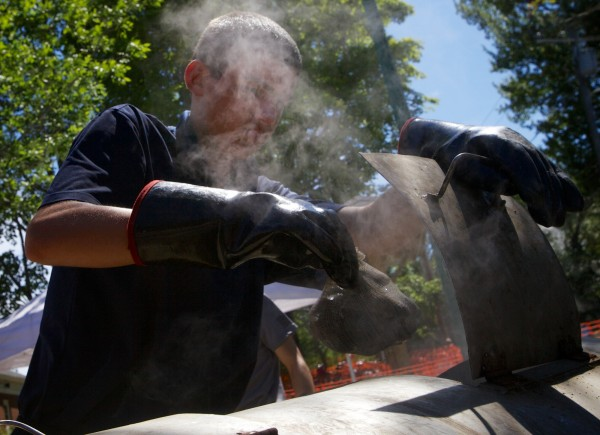 Jack Amoroso takes steamers out of a warmer before serving them at the 47th annual Yarmouth Clam Festival on Friday, July 20, 2012.