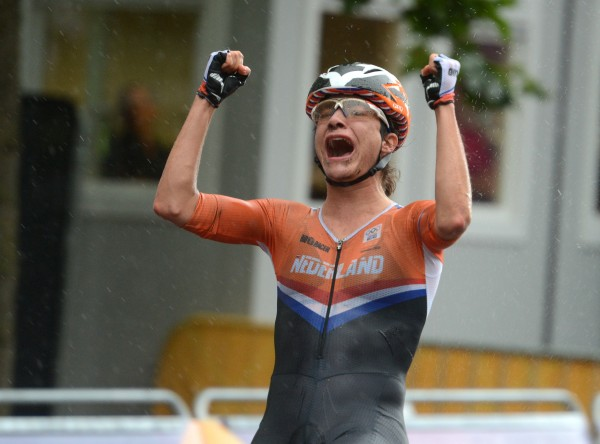 Marianne Vos of the Netherlands celebrates in the rain after winning the women's Road Race on Sunday, July 29, 2012, at the London 2012 Olympics.