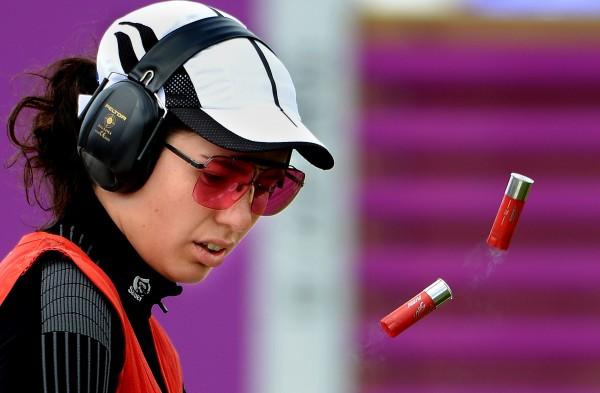 Turkey's Cigdem Oztaman empties her shotgun shells during the women's skeet event at the Summer Olympic Games in London on Sunday, July 29, 2012.