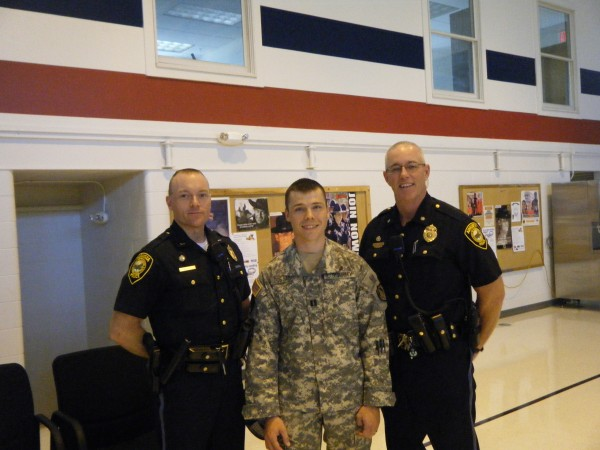 Augusta police officer Eric Dos Santos (center) poses with Lt. Kevin Lully and Chief Robert Gregoire after he was given command of the 488th Military Police Company, which is heading to Afghanistan for a year. Dos Santos is an Army Captain. The unit's sendoff ceremony is 10 a.m. Saturday, July 21, 2012 at the Augusta Civic Center.