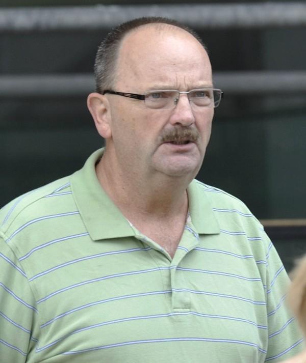 Robert Rossignol of Van Buren leaves federal district court in Bangor after being arraigned on drug smuggling charges on Friday, July 27, 2012.