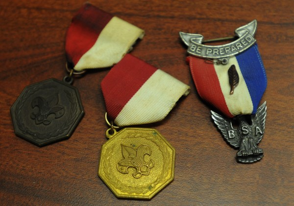 A selection of medals that Dr. Mark Varnum, a former Eagle Scout, is returning to the Boy Scouts of America for what he calls their &quotbigoted policies&quot toward openly gay Scouts and leaders are seen on his desk in Bangor on Monday, July 30, 2012.