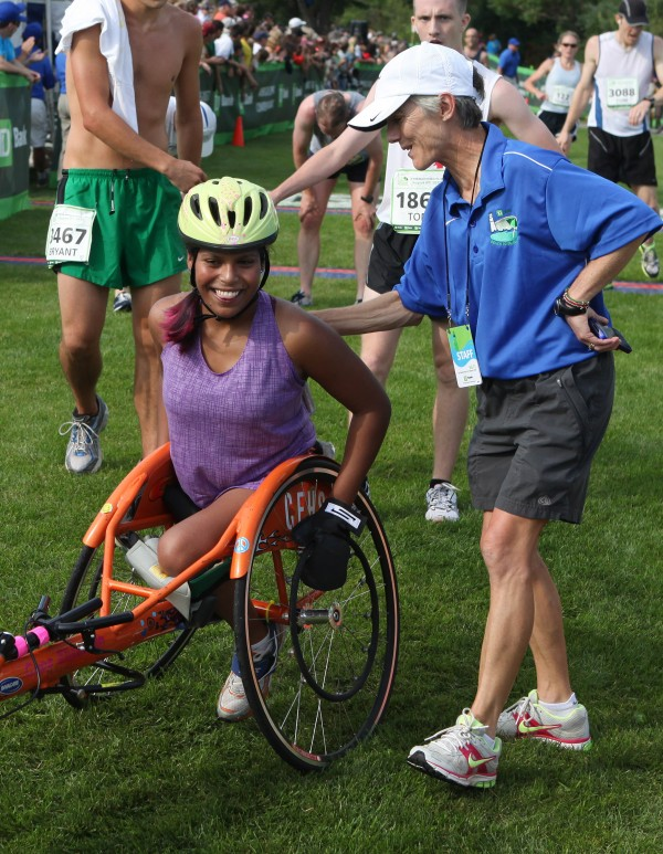 TD Bank Beach to Beacon 10K founder Joan Benoit Samuelson (right) congratulates Christina Kouros, of Cape Elizabeth (left) after the women's wheelchair chase in August 2011 in Cape Elizabeth.