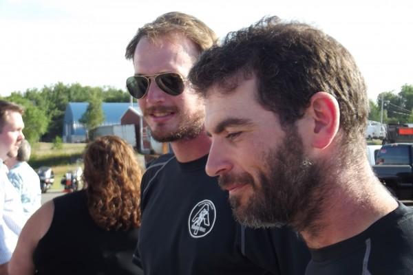 Former Marine Corps Capts. Mark Silvers (left) and Sean Gobin (right)speak with veterans on Tuesday, July 31, 2012 before the start of a fundraising dinner and ceremony commemorating Silvers' and Gobin's 2,180-mile Appalachian Trail trek. The men have raised more than $30,000 during their hike to help wounded veterans purchase adaptive vehicles.