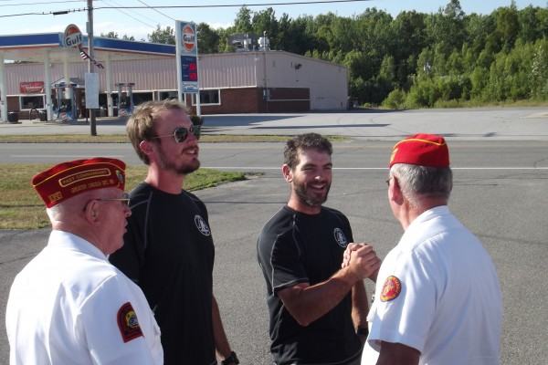 Former Marine Corps Capts. Mark Silvers (left) and Sean Gobin (right) are greeted by members of the Bangor and Lincoln detachments of the Marine Corps League on Tuesday, July 31, 2012 before the start of a fundraising dinner and ceremony commemorating Silvers' and Gobin's 2,180-mile Appalachian Trail trek.