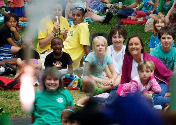 Children and camp counselors watch a test tube lame up during a science show put on by the University of Southern Maine Chemistry Club in Portland's Deering Oaks Park on Thursday, July 26, 2012.