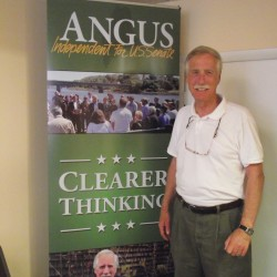 Former Gov. Angus King stands in front of a campaign sign in his newly opened office in downtown Presque Isle on Friday, July 20, 2012. King is running in the race to replace Olympia Snowe in the U.S. Senate. The new office is located at 168 State Street in Presque Isle.