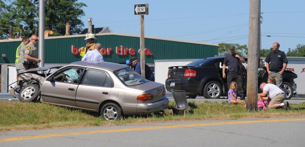 First responders attend to people who were in the two vehicles that collided at the intersection of Cold Brook Road and the off ramp of the I-95 southbound lane in Hermon on Friday, July 20, 2012.