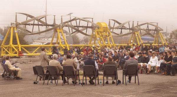 With the underwater turbine in the background, U.S. Department of Energy's Deputy Assistant Secretary for Renewable Energy Steven Chalk addresses the attendees of the Cobscook Bay Tidal Energy Dedication Ceremony in Eastport on Tuesday, July 24, 2012.