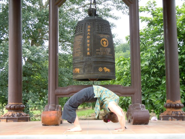 Orono yoga teacher Sandy Cyrus in Wheel Pose at Plum Village.